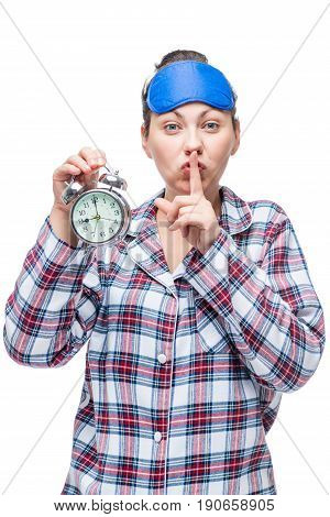 Caucasian Woman Shows Finger Gesture Quietly And Shows Time On Alarm Clock