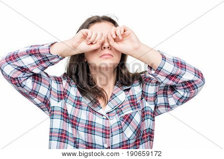 Girl After Waking Rubbing Eyes With Hands From Bright Light On White Background
