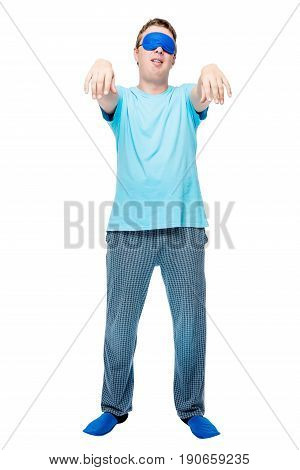 Portrait Of A Sleepy Man In Pajamas On A White Background Suffers From Sleepwalking