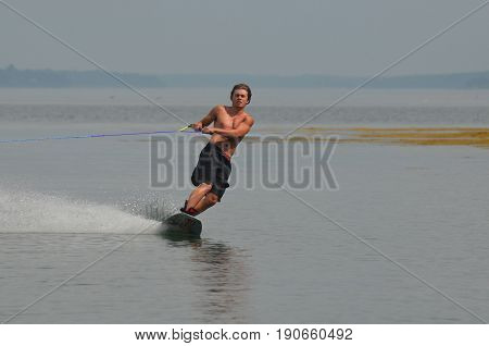 Perfect summer day riding a wakeboard on the ocean in Maine.