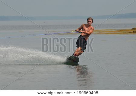 Wakeboarding on a summer day around islands in Maine.