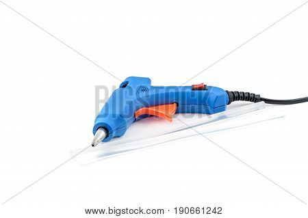 Glue gun with glue rods on a white background.