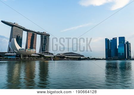 Marina Bay In Sunny Day And Marina Bay Sands Hotel