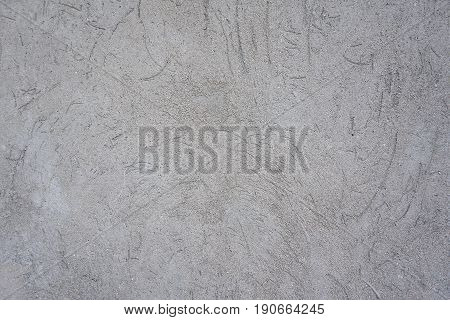 plastered with concrete wall. Gray wall glue plaster comb surface prepared for tiling