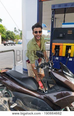 Man Fuel Motor Bike, Happy Smiling Hispanic Guy On Gas Station Buy Patrol