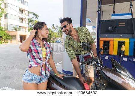Couple On Gas Station Man Fuel Motor Bike, Happy Smiling Hispanic Guy Buy Patrol