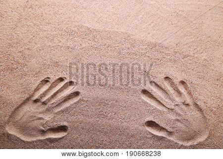 Handprints on the beach sand, close up