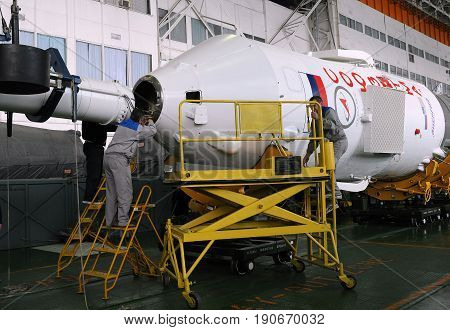 BAIKONUR COSMODROME KAZAKHSTAN - DECEMBER 18 2011: Soyuz spacecraft capsule is being mated with its booster rocket in the Integration facility building