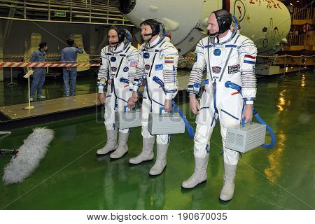 BAIKONUR, KAZAKHSTAN - DECEMBER 9, 2011: ISS 31 crew (L-R: Don Pettit, Oleg Kononenko, Andre Kuipers) answer journalists' questions after fit check at Baikonur Cosmodrome