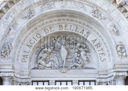 MEXICO CITY MEXICO - APRIL 19 2017: Intricate sculptures compliment the name Palacio de Bellas Artes of neoclassical architectural style of this cultural center in Mexico City.