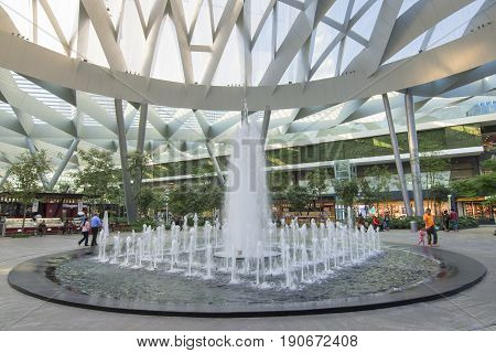 MEXICO CITY MEXICO - APRIL 20 2017: Toreo Parque Central shopping center in Mexico City features a huge park setting with a beautiful fountain in the center beneath a modern architecture style glass ceiling.
