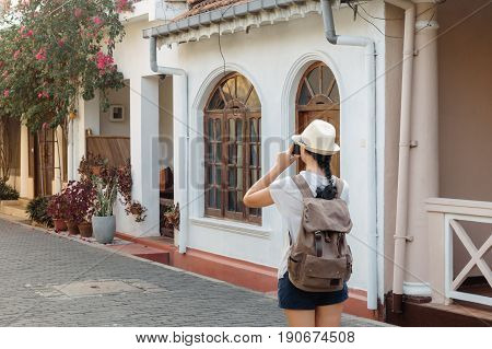 Girl Traveler With A Backpack And Camera On The Street Of The Fort Galle. Sri Lanka. Galle - The Lar