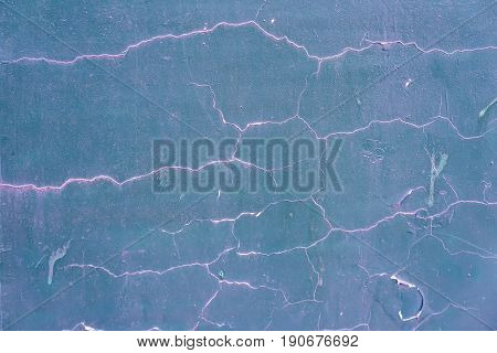 Grunge texture of cracked wall with the old and damaged stucco, plaster, blue-pink color texture. For modern background, pattern, wallpaper or banner design