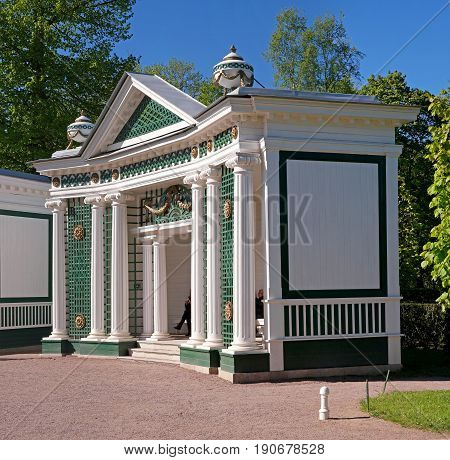 Petergof, Russia - June 5, 2017: The Marlinskaya Alley. A trellis arbor with cannoned columns, carved capitals, rosettes and garlands. It is located at the fountain -Adam- and -Eve-.