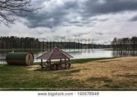Lithuania, Druskininkai - 04/30/2016: Bathhouse and gazebo on the shore near the forest lake