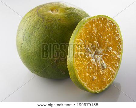 a whole orange and a slice of orange