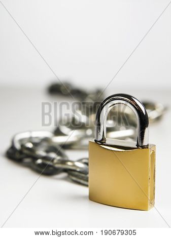 Padlock and chain, focus on foreground
