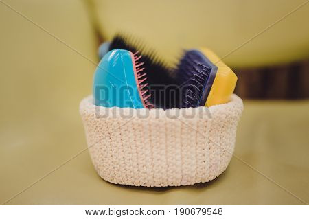 Basket With Combs And Round Hair Brushes