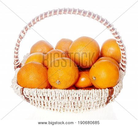 Lots of oranges in fruits basket isolated on white background