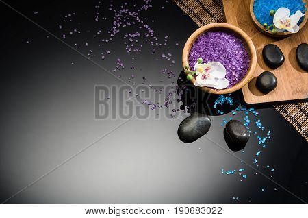 Spa concept background on black reflective background. Top view frame product photograph with copy space. Concept photograph with room for text or advertising.