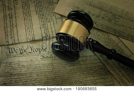 Court gavel on pages of the United States Constitution