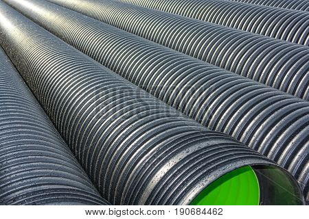 Corrugated water pipes of large diameter prepared for laying poster