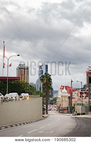 Kuala Lumpur, Malaysia - February 7, 2016: Jalan Sultan Hishamuddin with traffic jams City Centre of Kuala Lumpur, Malaysia. Beautiful historic buildings can be seen in the distance