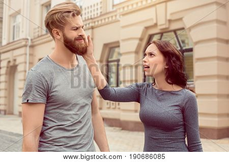 Young couple woman and man tourists city walk together vacation quarrel