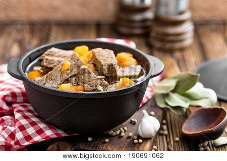 Delicious braised beef meat in broth with vegetables goulash