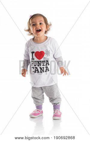 Varna Bulgaria 02.April.2017 - Happy little baby girl with t-shirt screaming: I love Punta Cana