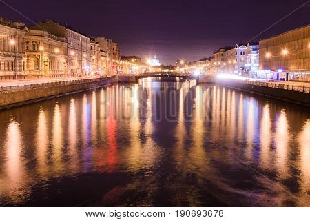 View of Lomonosov bridge across the Fontanka river Saint-Petersburg at night anover side