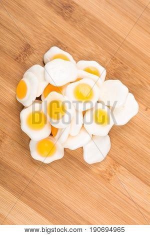 Fried Gummy Eggs On A Wood Background