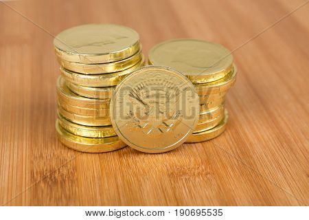 Chocolate Gold Coins On A Wood Background