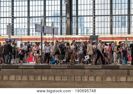 People Standing  On Platform And Waiting For S-bahn Train Station