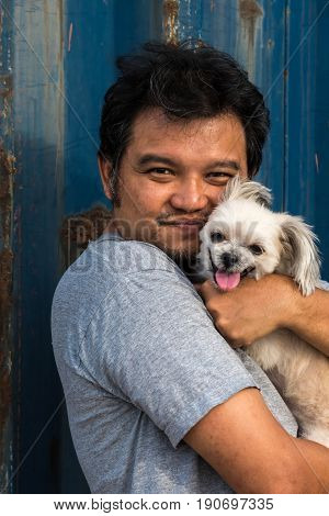 Asia Man And Dog Happy Hugging With Container