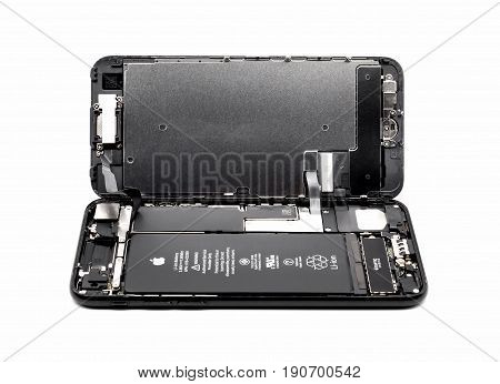 Chiangrai Thailand: May 19 2017 - Apple iPhone 7 jet black color disassembled for repair and showing components inside on white background. Selective focus