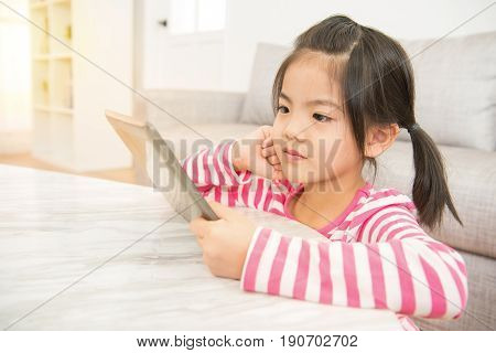 Girl Enjoy Watching Video Cartoon On Pad