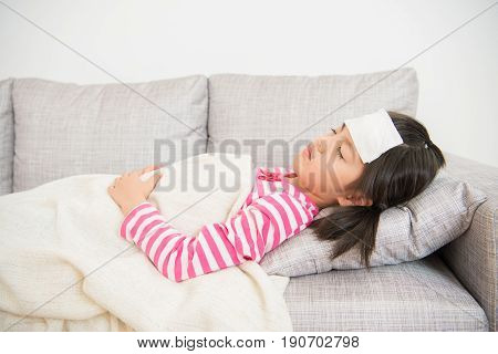 Girl Sleeping And Sick On Sofa