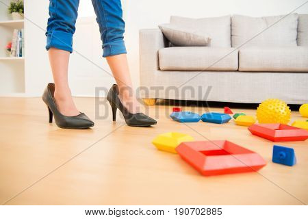 Girl Quietly Playing Her Mother Shoes