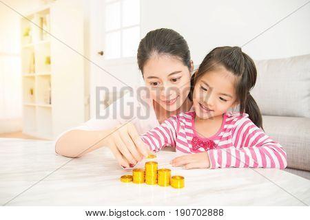 Mother Teach Daughter Calculate Money