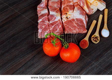 Fresh pork meat on wooden Board for cutting Pork fat with spices on a wooden board