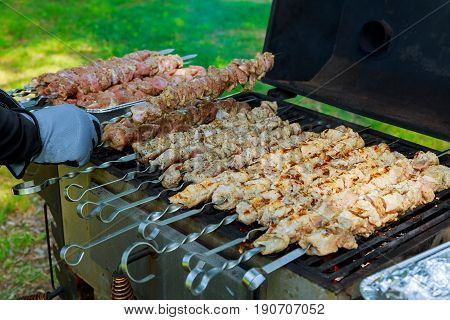 Grilled meat roasted skewers barbecue. Barbeque churrasco meat background. Appetizing meat roasted BBQ grill.