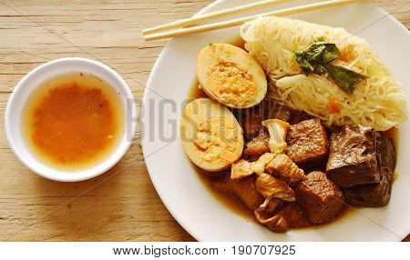 thin rice noodle with pork entrails and tofu topping egg on dish