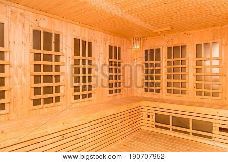 Wooden interior of infrared sauna room new technology of healthcare and relaxation in spa service.