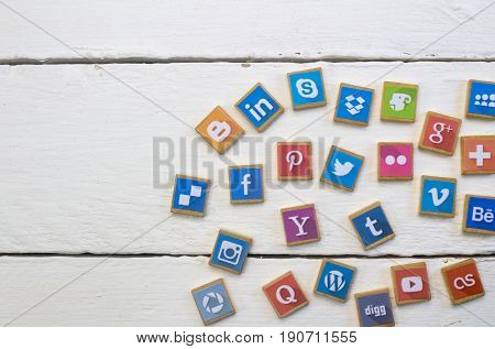 QUEENSTOWN SOUTH AFRICA - 09 APRIL 2017: Social Media logotype popular collection printed and place on wood scrabble game pieces isolated on white wood planks