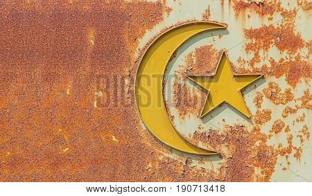 old islam symbol on rusty metal, concept