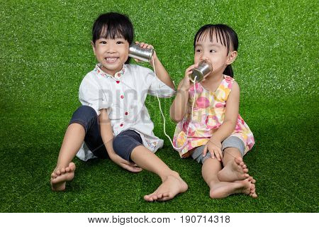 Asian Chinese Kids Playing With Tin Can Phone