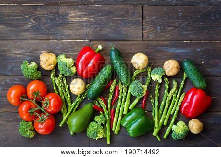 Food background. Variety vegetables. Top view of group vegan product - pepper avocado broccoli cucumber limepotatoasparagustomato. Healthy eating concept. Copy space