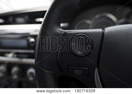 Control Buttons On Steering Wheel In A Modern Car. Soft Focus.