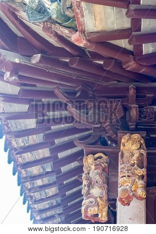 Traditional Chinese architectural eaves design. Image shows layered wooden joinery without use of nails.